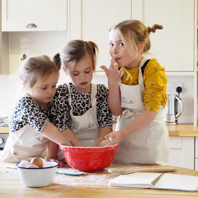 My children baking biscuits together in their Sparks and Daughters aprons