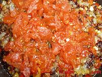 Chopped tomato frying