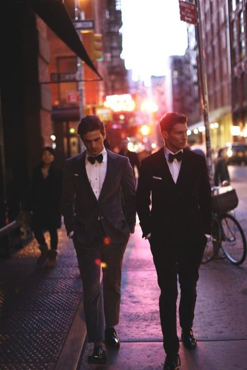 two-young-handsome-suited-gay-gentlemen-walking-streets