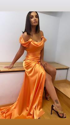 Elettra Lamborghini vestito elegante arancione tacchi alti finale Isola Dei Famosi 7 giugno