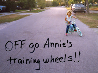 "Little girl on bike with caption ""Off go Annie's training wheels!!"""