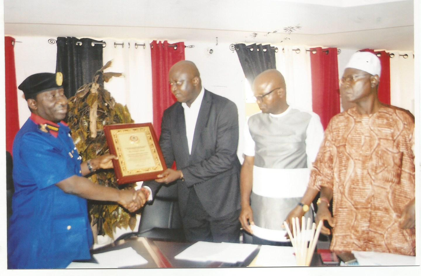 Photo News: AWARD: From left, Recipient and Commandant-General