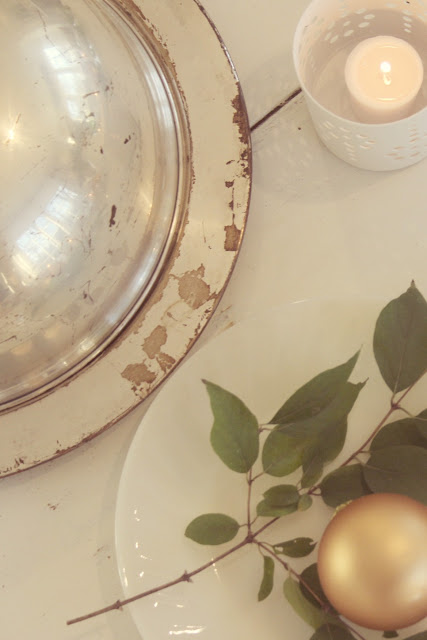 Vintage silver on white farmhouse table with gold and greenery