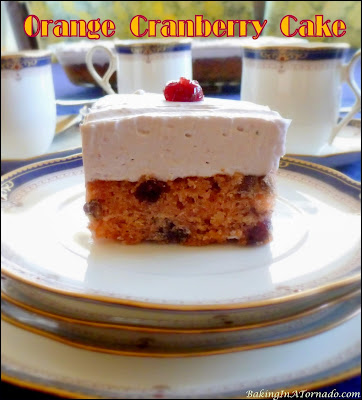 Orange Cranberry Cake features favorite seasonal flavors. This cranberry studded orange cake is frosted with cranberry whipped cream. |  Recipe developed by www.BakingInATornado.com | #recipe #cake