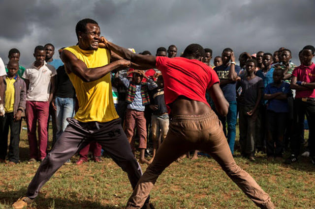 Brothers fighting because of their wives photo