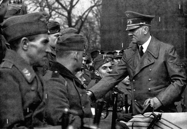Hitler greets disabled veterans, 15 March 1942 worldwartwo.filminspector.com