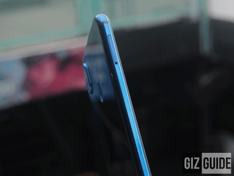 Hybrid dual SIM/microSD tray at left