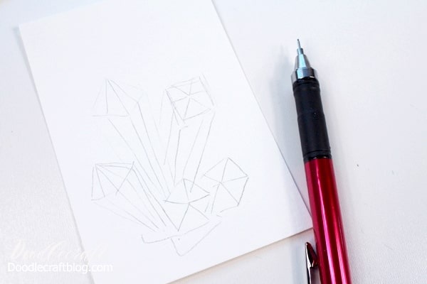 Sketch a crystal cluster with pencil on watercolor paper.