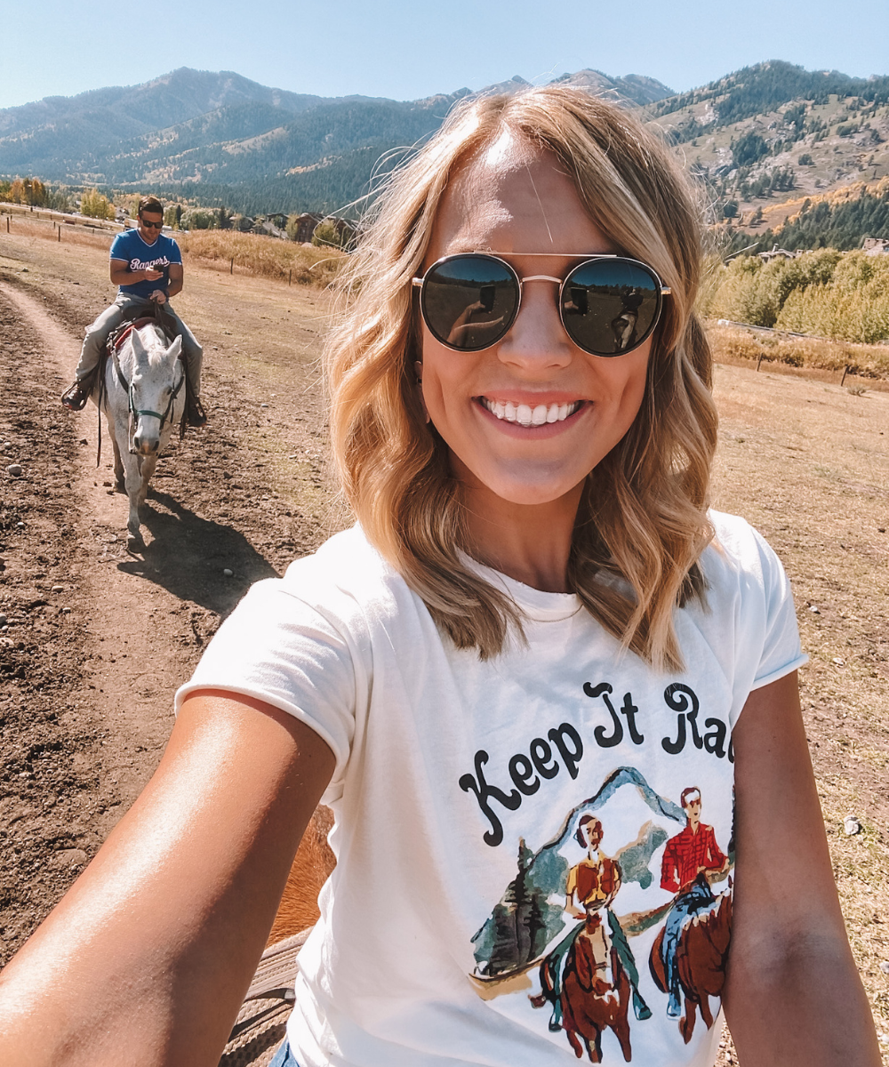 travel blogger @amandasok rides horses while visiting Jackson Hole, Wyoming