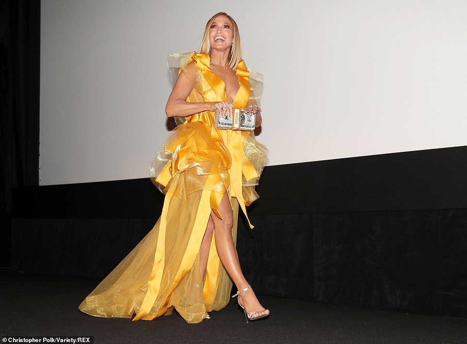 Jennifer Lopez sizzles in a deeply low-cut yellow gown with tulle detailing at the Hustlers premiere during the Toronto International Film Festival