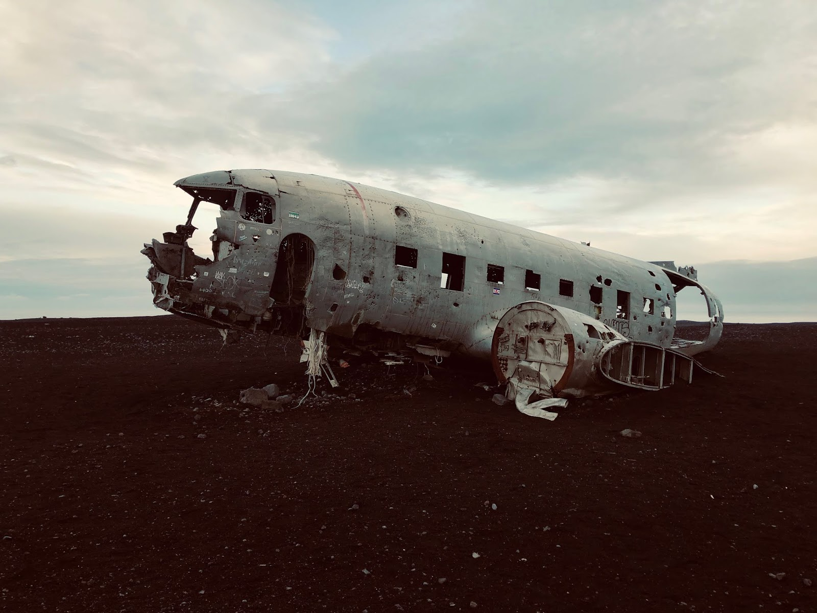 Abandoned DC Plane on Sólheimasandur, hiking and running in iceland, running to the Abandoned DC Plane, Sólheimasandur, hiking in iceland, iceland hikes, running around, hiking up mountains, mountain runner, mountains, lava rocks,