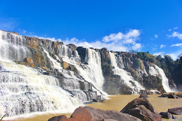 The massive walls of Pongour waterfalls in Da Lat Vietnam