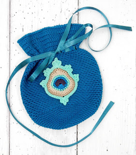 Free crochet pattern by thecuriocraftsroom gift pouch project pouch home decor peacock feather