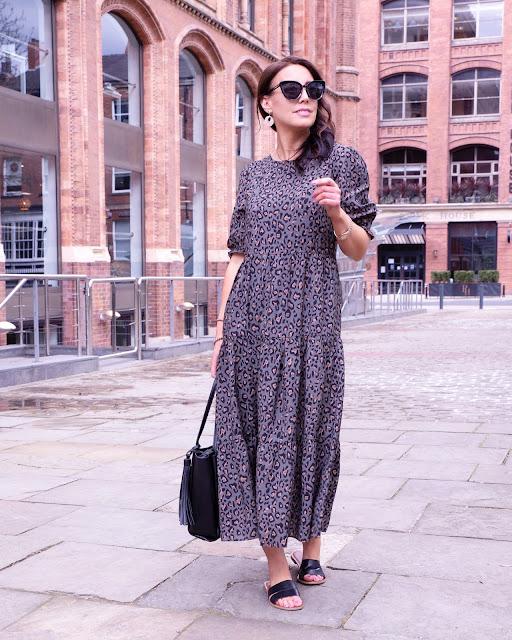 woman in animal print midi dress