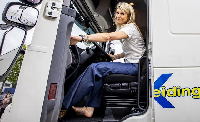 Queen Maxima wore a white silk top from Natan, and denim trousers from Natan. Transport and Logistics sector