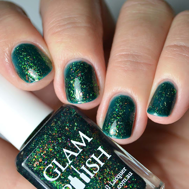 green flakie nail polish four finger swatch