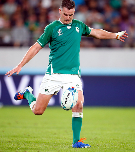 Johnny Sexton of Ireland kicks out of hand against New Zealand in their 2019 RWC quarter-final
