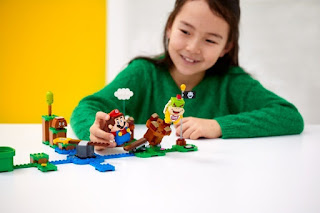 Girl is playing with LEGO Super Mario Toys