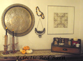 Vintage bobbin spool and spring fall decor display in dinning room