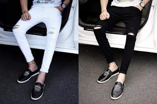 Two guys sitting wearing a black and a white jeans