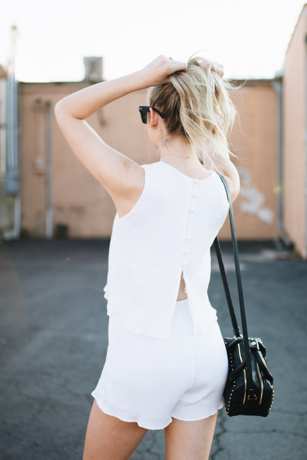 white romper with buttons down the back