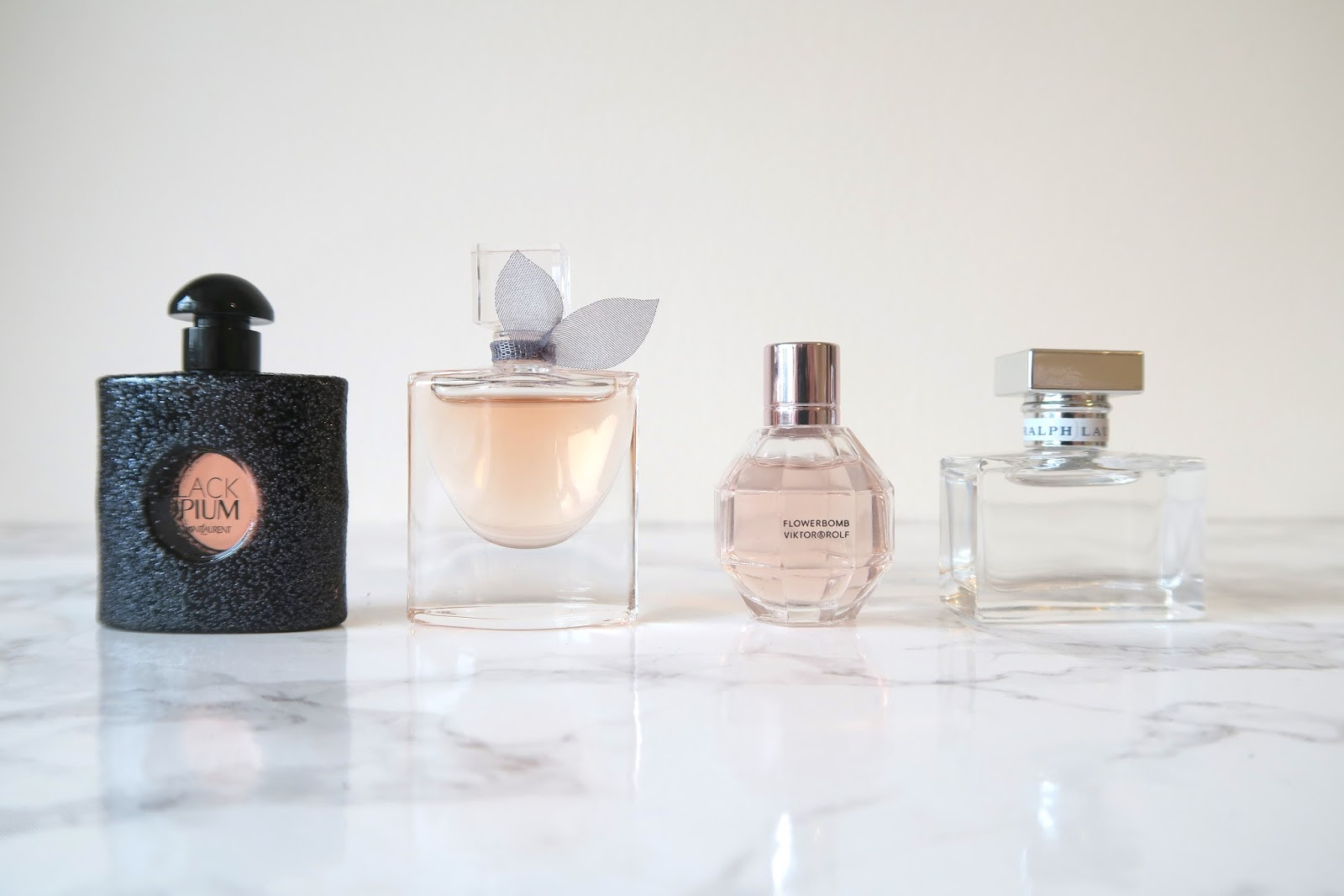Four mini perfumes from YSL, Lancome, Viktor and Rolf and Ralph Lauren