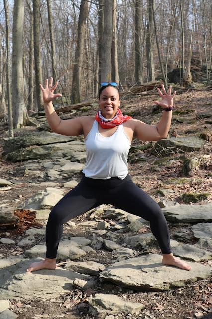 Black woman yoga outdoors goddess pose