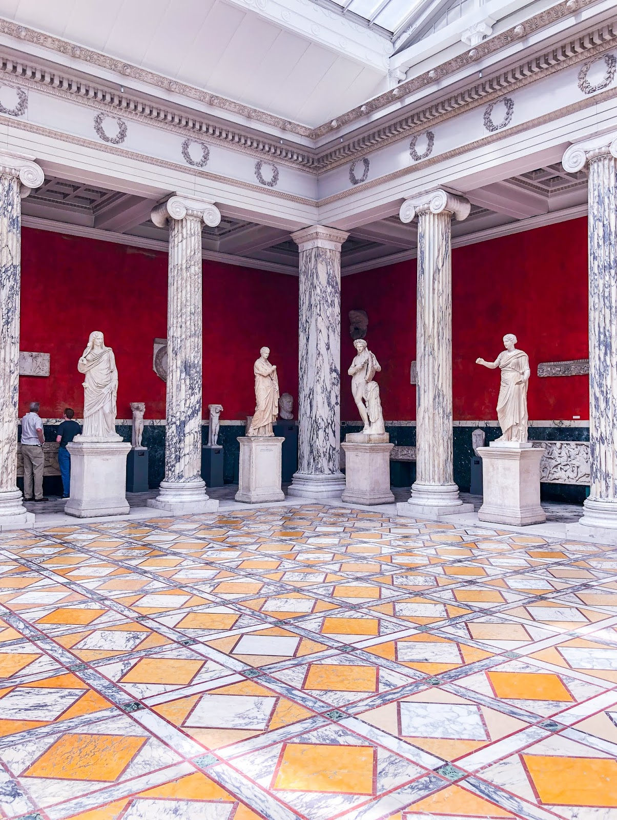 sculptures lining marble room in ny Carlsberg glyptotek gallery in Copenhagen