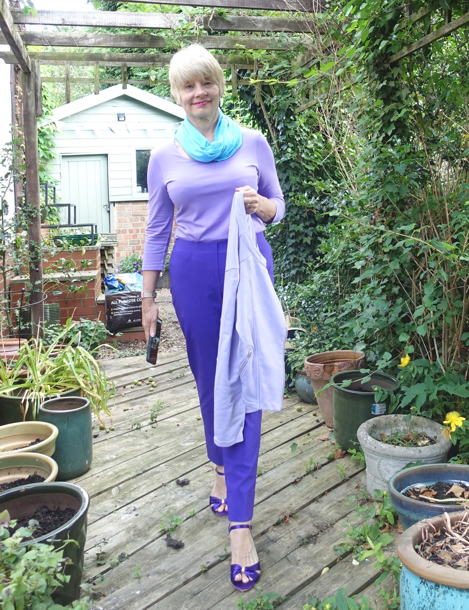 If a favourite colour isn't in your colour palette, make it work by wearing a more flattering colour next to the face. Is This Mutton blogger Gail Hanlon wears a bright blue Aquarius scarf by Kettlewell to brighten up a Wisteria top that might be too muted otherwise.