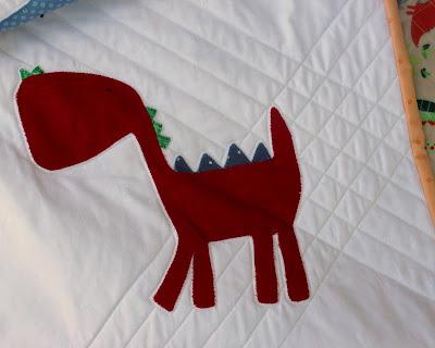 red dinosaur quilt block