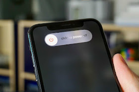 Photograph of an iPhone with the phone's switch off option on the screen