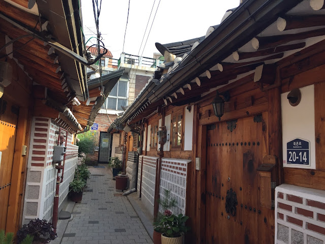 Bukchon Hanok Village in Seoul is a great place to visit early in the morning. You don't need to worry about an opening time so if you are an early riser you can get there to take photos before it's overrun with tourists!