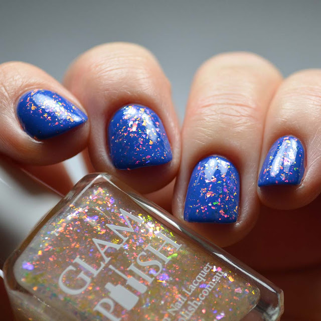 rainbow flakie nail polish swatched over blue
