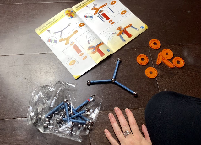 The instructions for the initial motor, orange plastic pieces and magnetic balls and rods