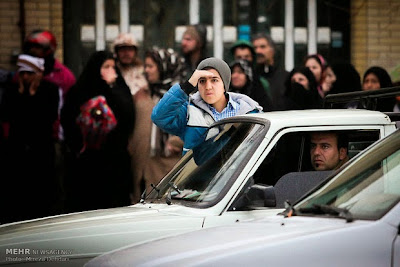 A mesmerized teenage boy watches a public execution in Iran.