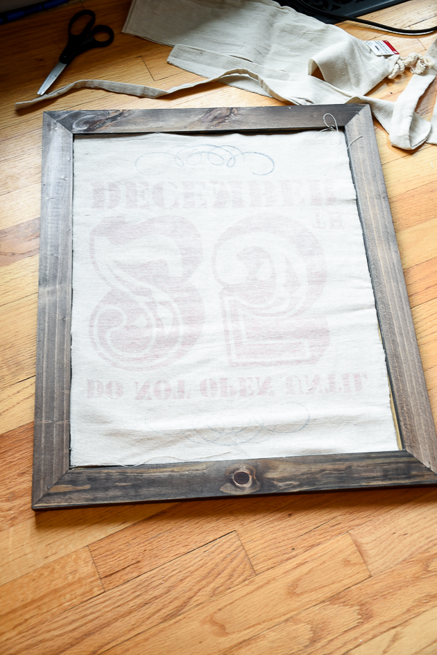 Holiday decorating, putting Christmas sack into frame, Christmas decor, mudroom