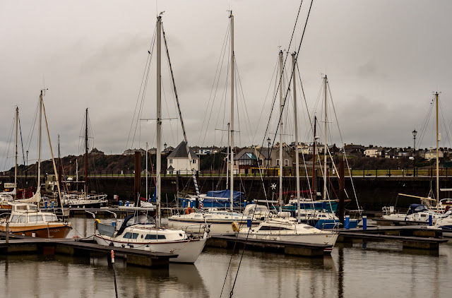 Photo of the same view of Maryport Marina in grey cloud on Tuesday