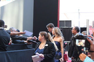 Nathan Fillion signing autographs