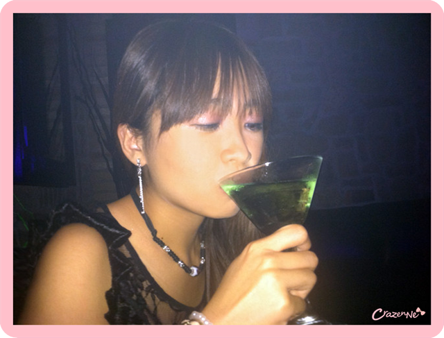 drinking green apple martini