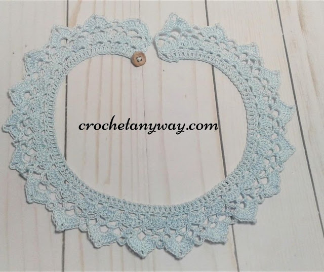finished crochet collar with button in blue cotton crochet thread