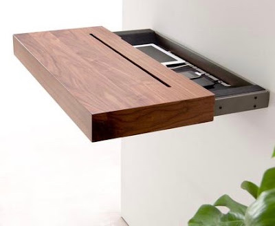 wood shelf pulled out from the wall showing the interior with two products charging inside