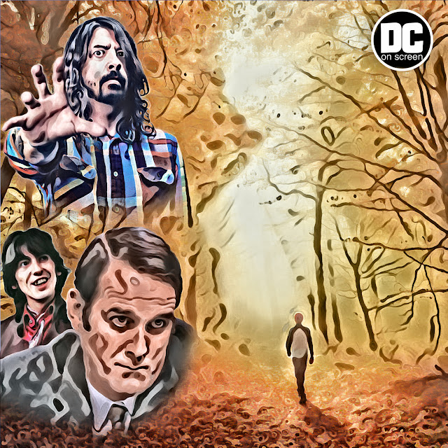 A man wanders deliberately towards a clearing in the forest in the silhouette of a woman with ghostly visages of John Cleese, George Harrison, and Dave Grohl in the foliage. Text: DC on SCREEN
