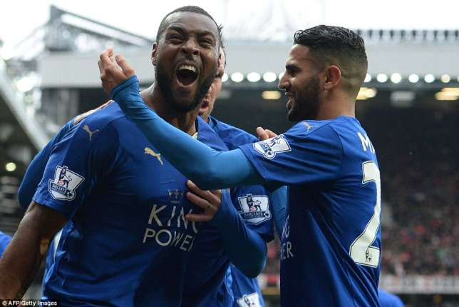 Wes Morgan celebrates with Riyad Mahrez after scoring the equaliser