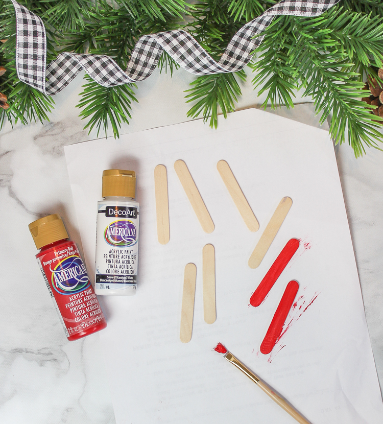 Make these cute Santa ornaments using wooden craft sticks