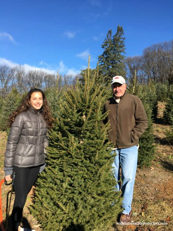 My brother and niece Gracie with the Christmas tree they picked out from Walking on Sunshine.