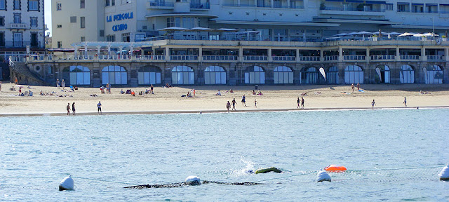 Swimming across the bay at Saint Jean de Luz. Pyrenees-Atlantiques. France. Photographed by Susan Walter. Tour the Loire Valley with a classic car and a private guide.
