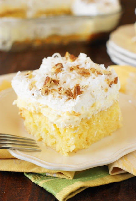 Hawaiian Dream Cake ~ a layered delight with pineapple-and-coconut laced yellow cake base, layer of creamy pineapple pudding, and freshly whipped cream and coconut topping.  Cool, creamy, & comforting!   www.thekitchenismyplayground.com