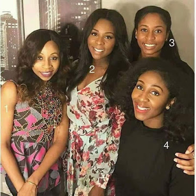Here is a picture of a mother and her three daughters . Can you tell which is the MOTHER??