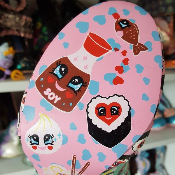 close up of shoe sole in pink with cute sushi face print