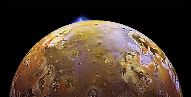 Io with a volcanic plume at the top. Credit: NASA